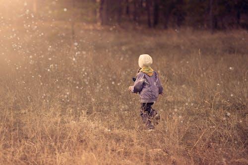 Child Walking on Grass Path