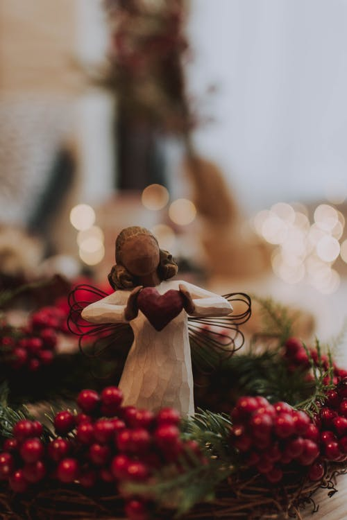 Photo Of Angel Figurine Standing On Garland