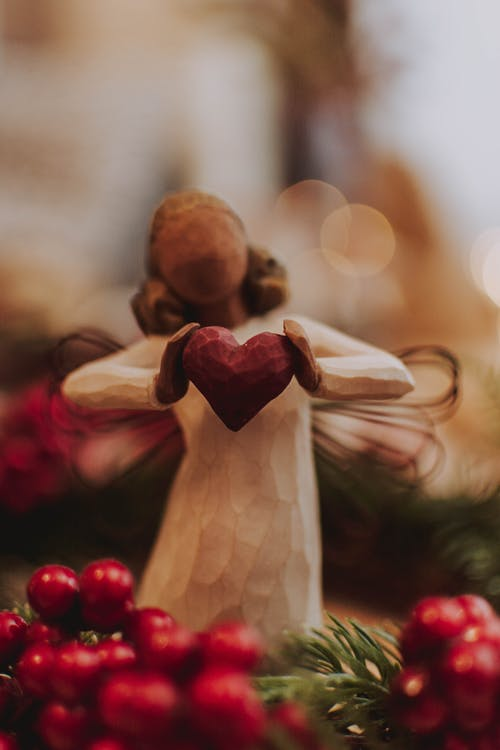 Figurine of angel carved from wood used as Christmas decor