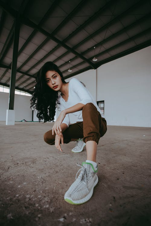 Photo Of Woman Wearing White Sneakers
