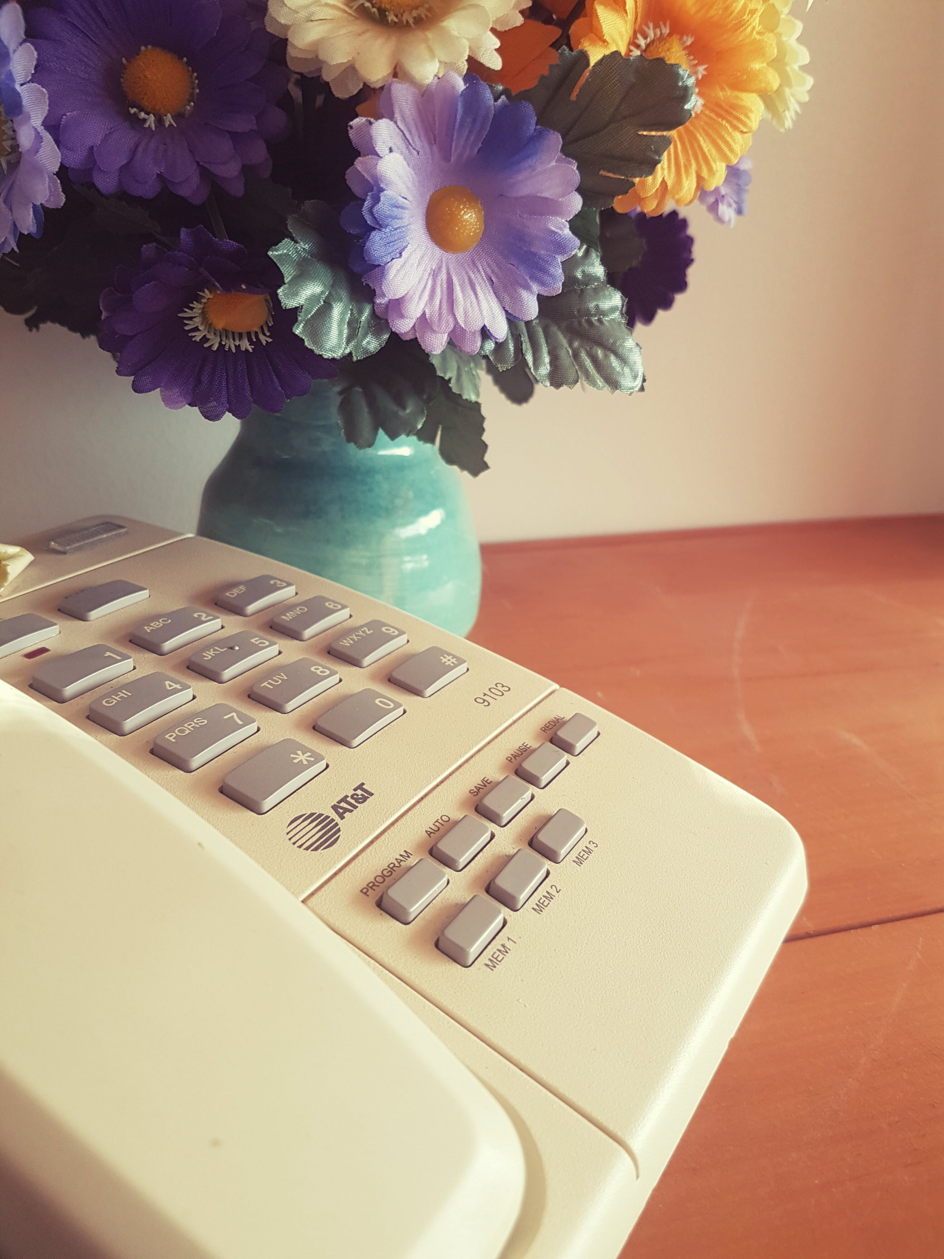 Free stock photo of artificial flowers, phone, sidetable, talk