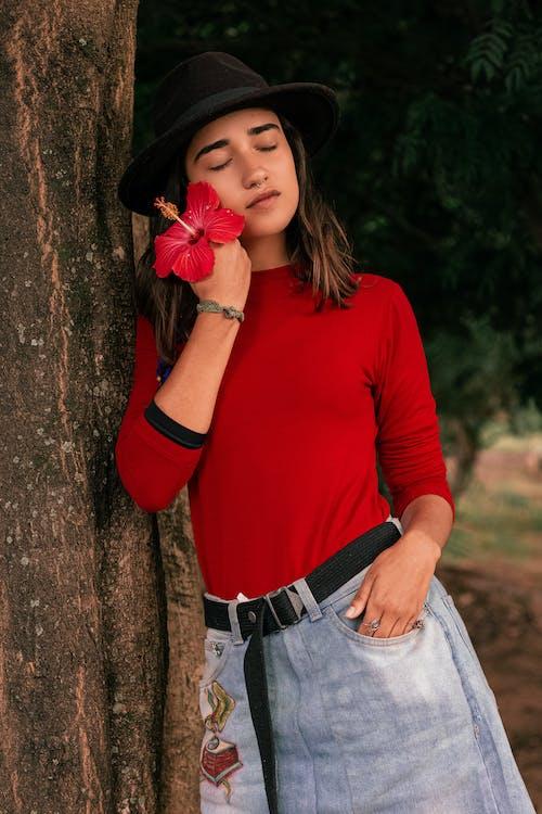 Photo Of Woman Wearing Denim Skirt