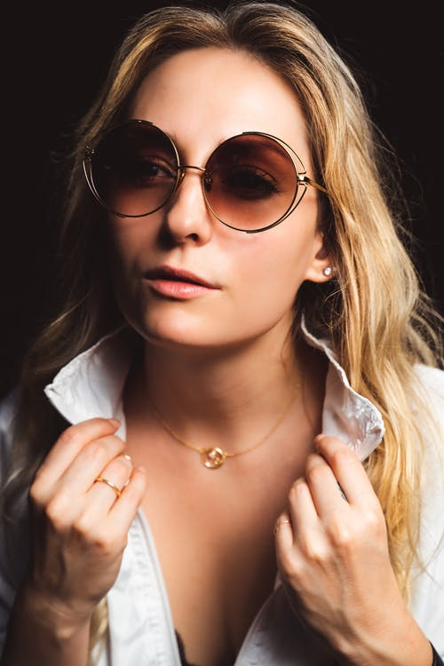 Close-Up Photo Of Woman Wearing Brown Sunglasses