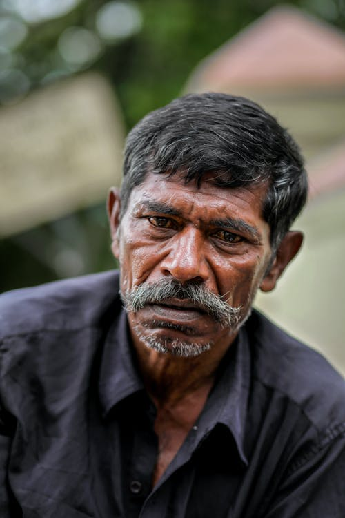 Portrait Photo Of An Old Man