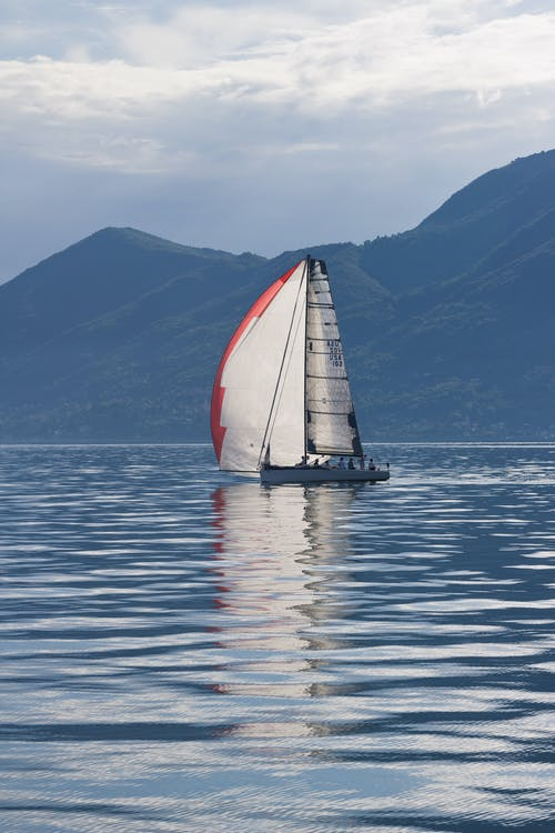 Photo Of Sailboat Near Mountains During Daytime
