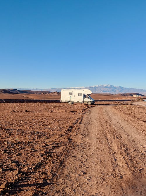 White Campervan on Dirt Road