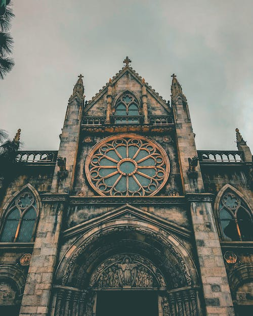 Photo Of Cathedral Under Cloudy Sky