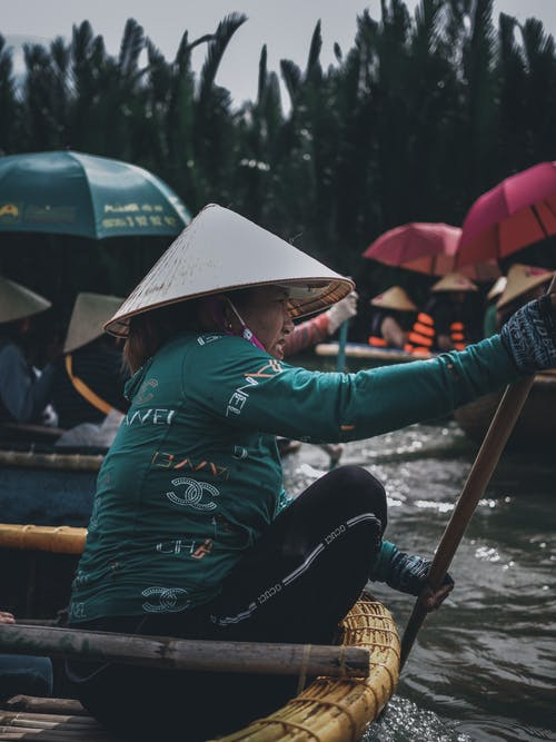 Photo Of Woman Holding Paddle