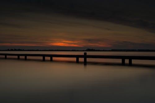 deniz, gün batımı, uzun pozlama içeren Ücretsiz stok fotoğraf