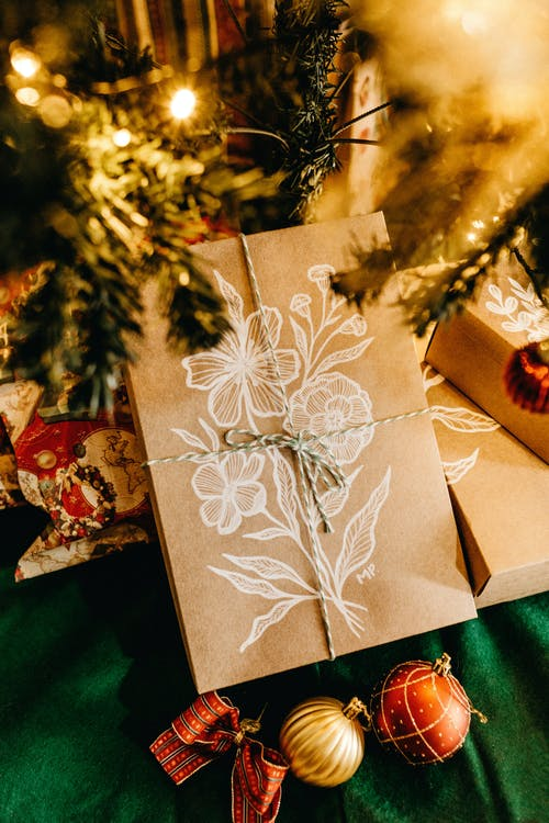 Brown Card Beside Christmas Tree