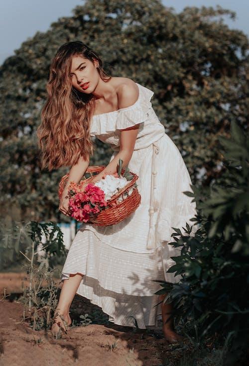 Photo of Woman Holding Wicker Basket