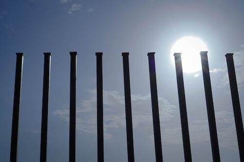 Free stock photo of divider, railings, sun