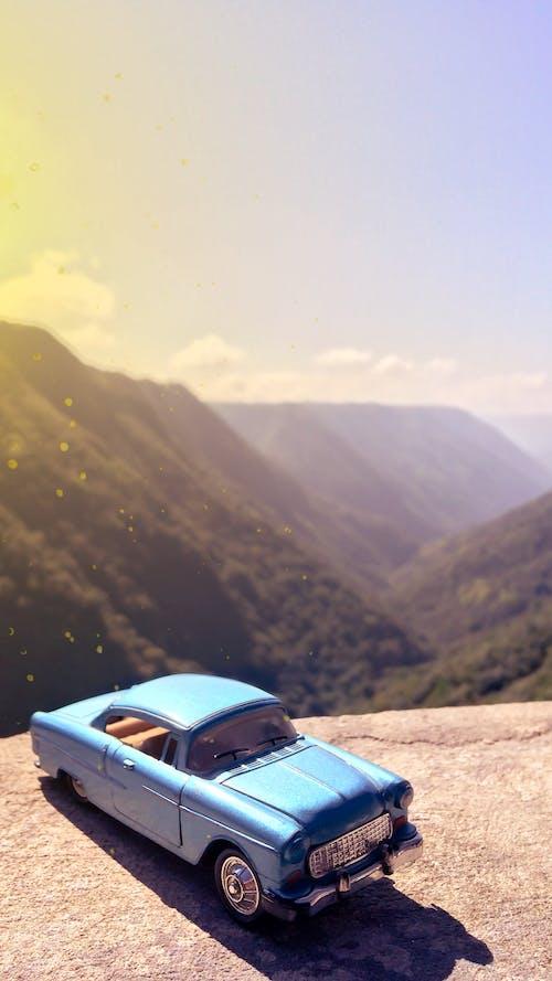 Fotos de stock gratuitas de carro azul, coche, juguete en miniatura