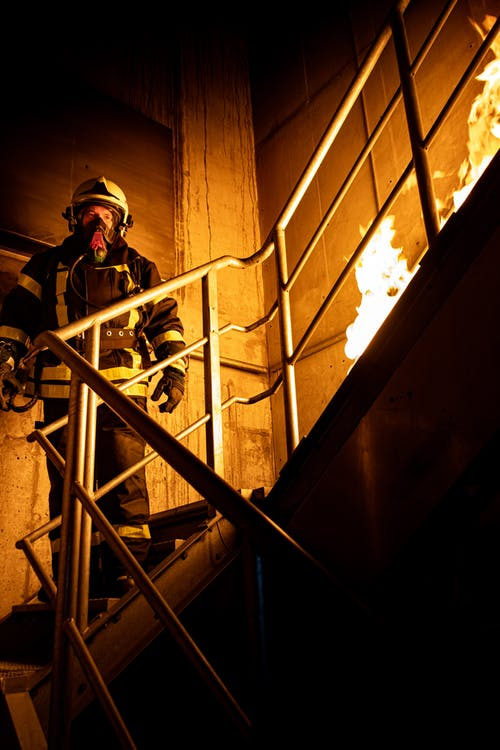 Firefighter Standing on Stairs
