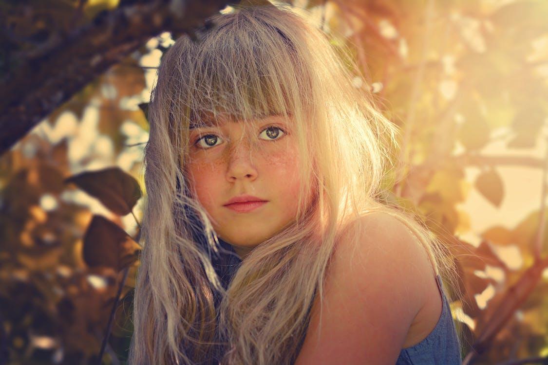 Girl Wearing Blue Top Near Tree