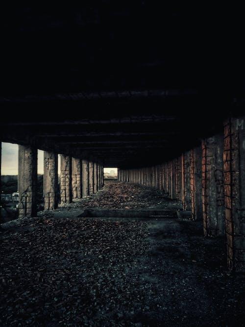 Dark corridor of abandoned city building