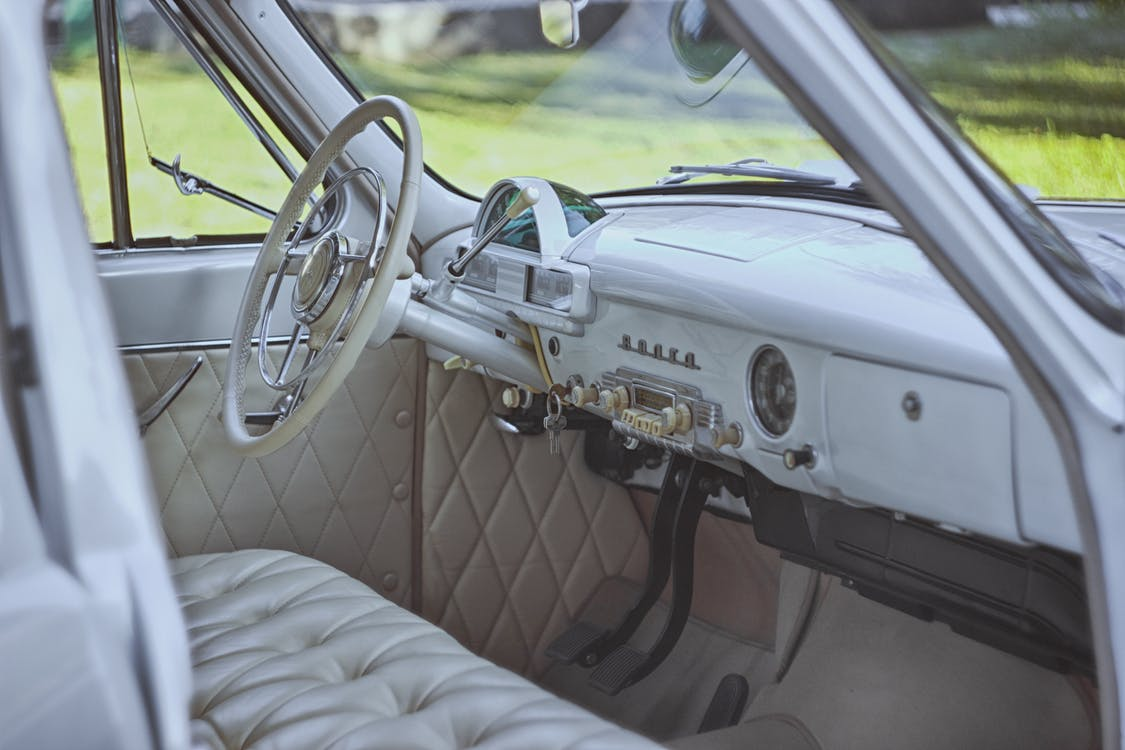 Selective Focus Photography of Gray Vehicle Interior