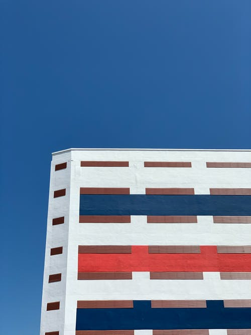 White and Brown Concrete Building Under Blue Sky