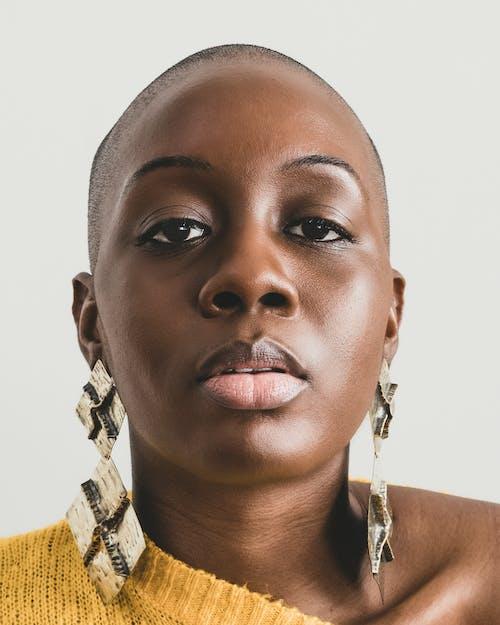 Woman Wearing Wearing Brown Earrings