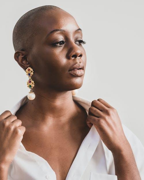 Woman Wearing Gold-colored Chandelier Earring