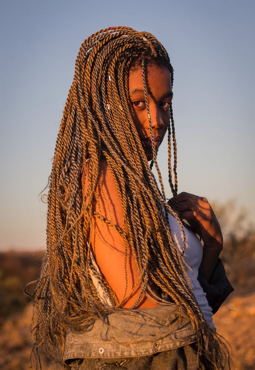 Photo Of Woman With Braided Hair