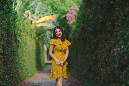 Woman Smiling While Wearing Yellow Floral Dress