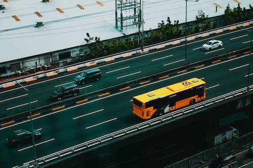 Various vehicles driving on asphalt road