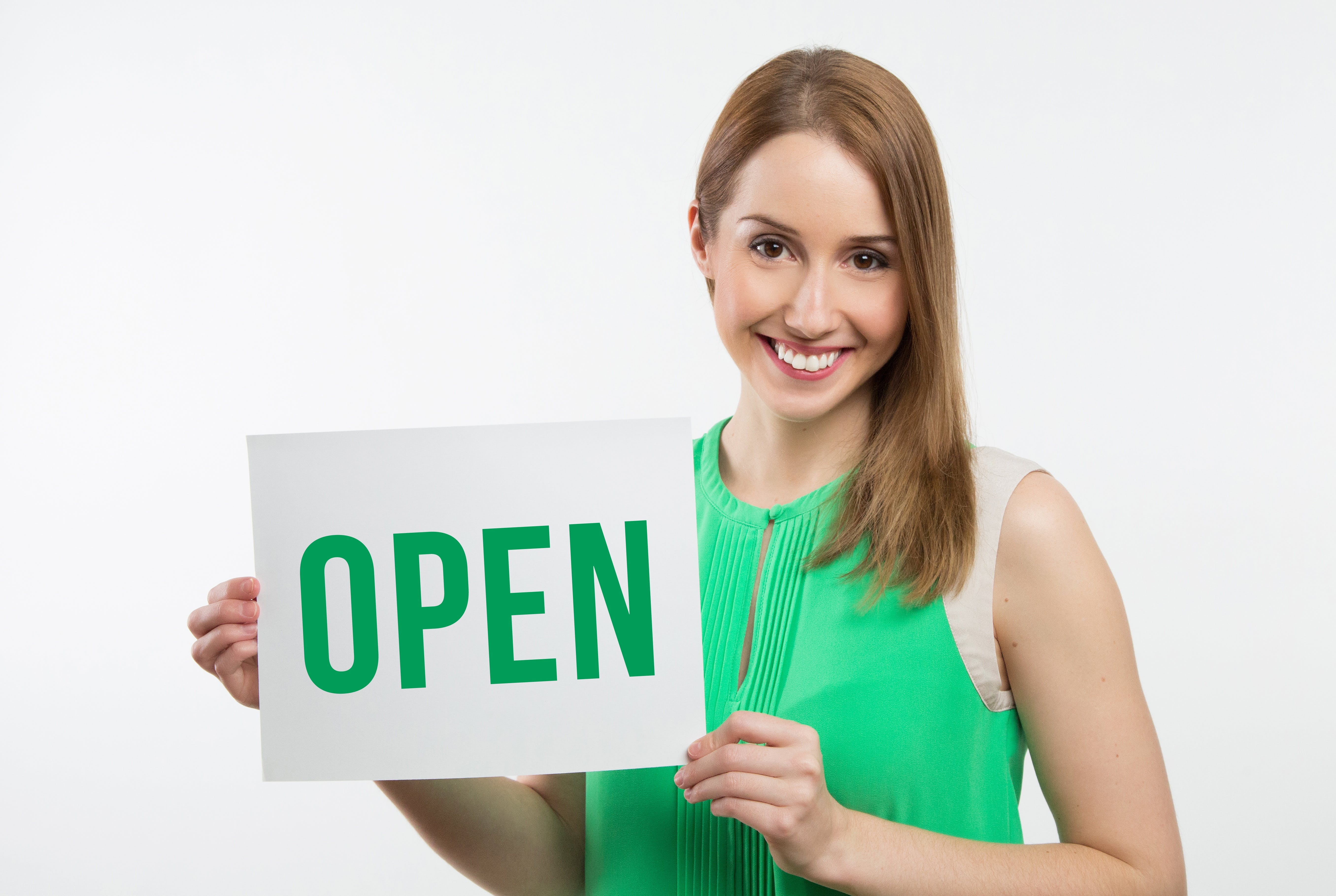Woman Holding Open Signage