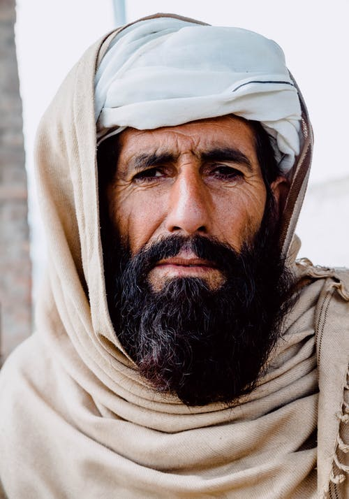 Man Wearing Brown Shawl