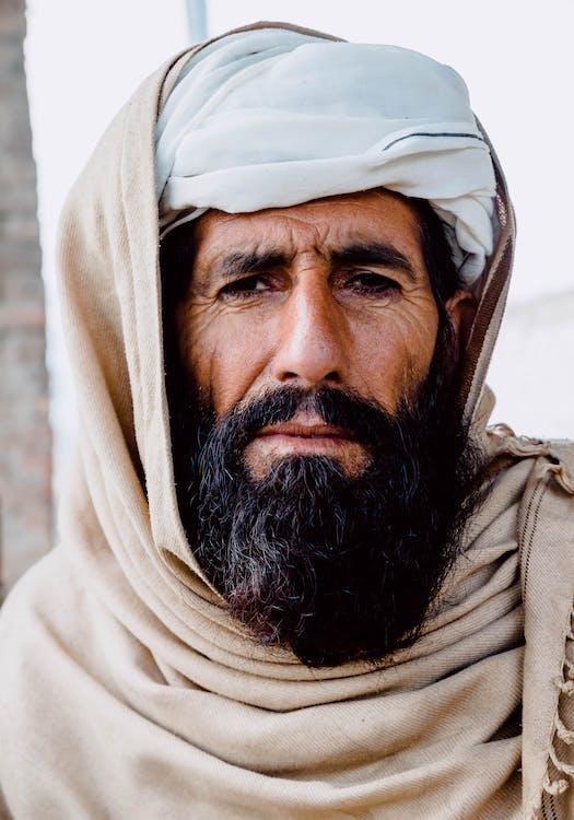 Man Wearing Brown Shawl
