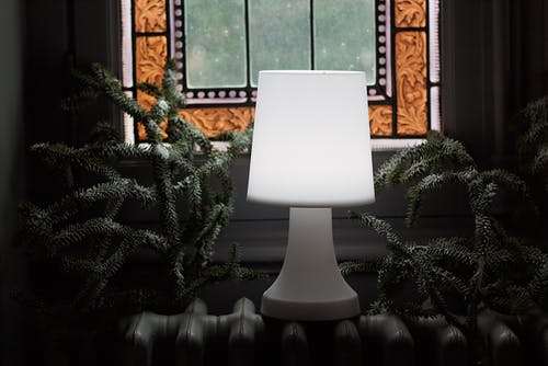 White Table Lamp on White Heater