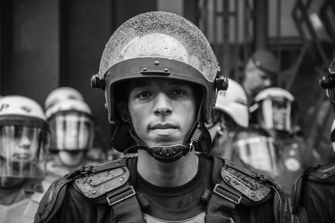 Grayscale Portrait Photo of Man Wearing Helmet