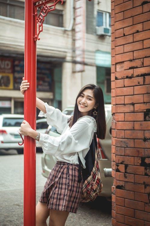 Happy young woman having fun in street
