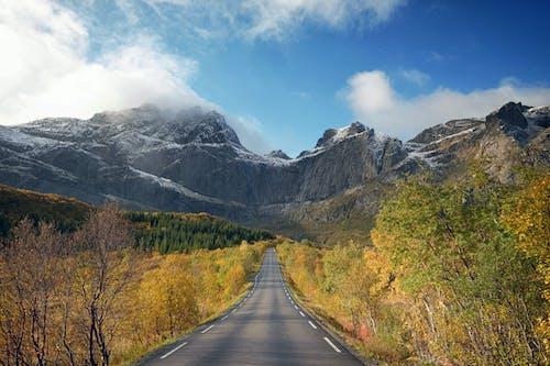 Empty Road Across Mountains