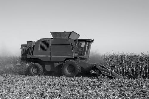 Grayscale Photo of Harvester