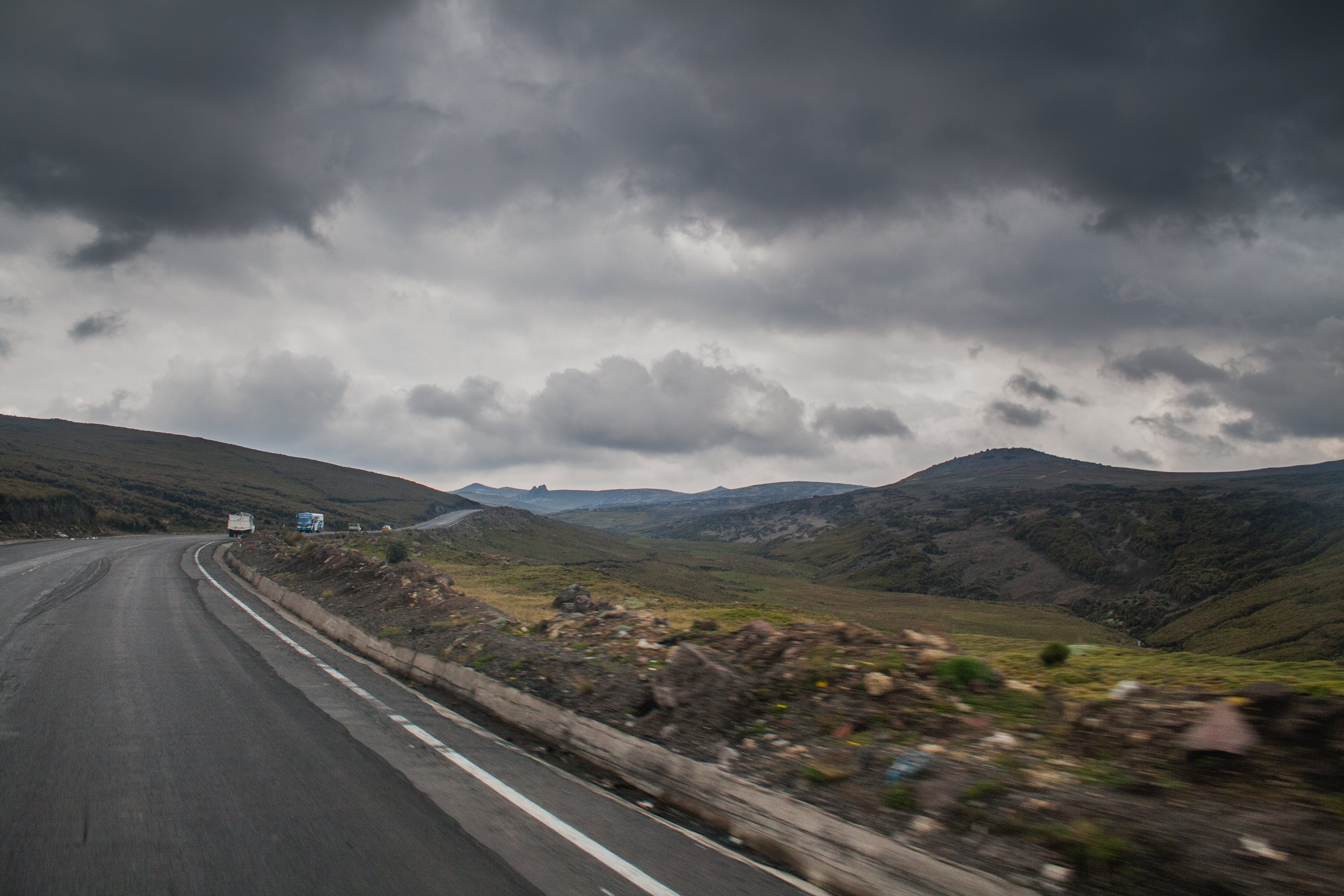 Road Near Brown Stone during Cloudy