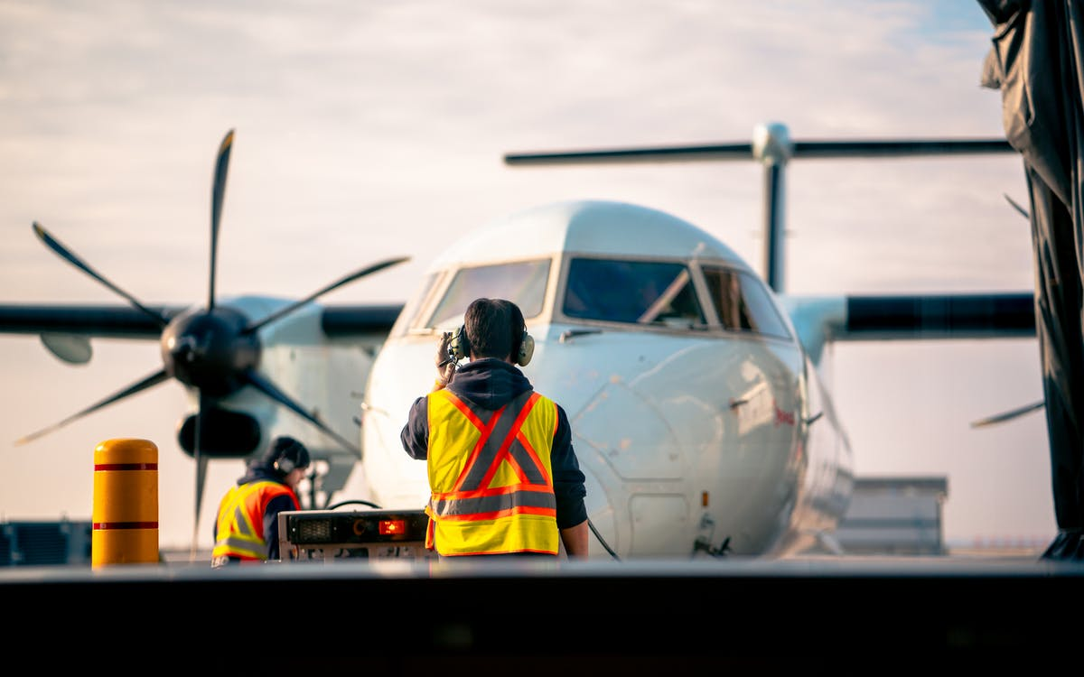Man Standing in Front of Airplane