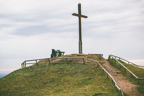 Cross on Hill With Fence