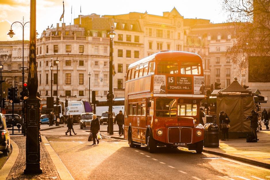 Red Double Decker Bus on Street Near People