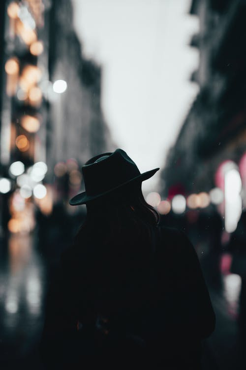 Silhouette of a Man Wearing Hat