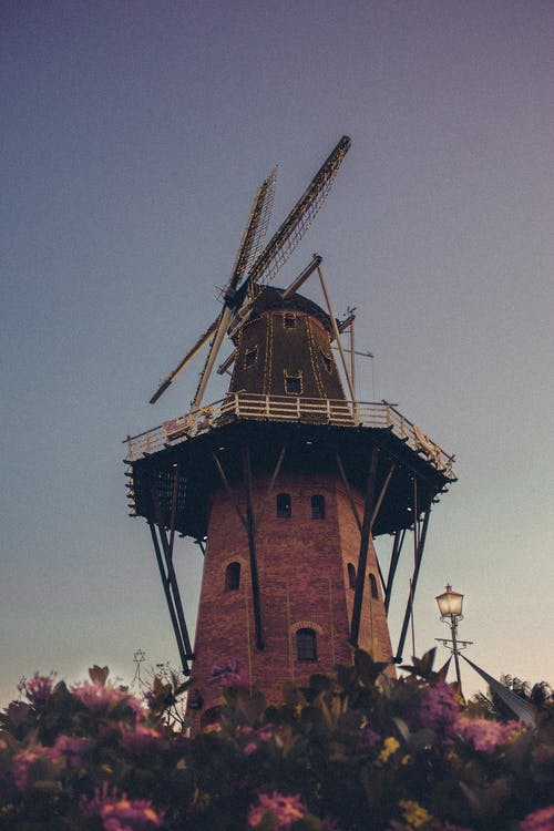 Architectural Photography of Brown Windmill