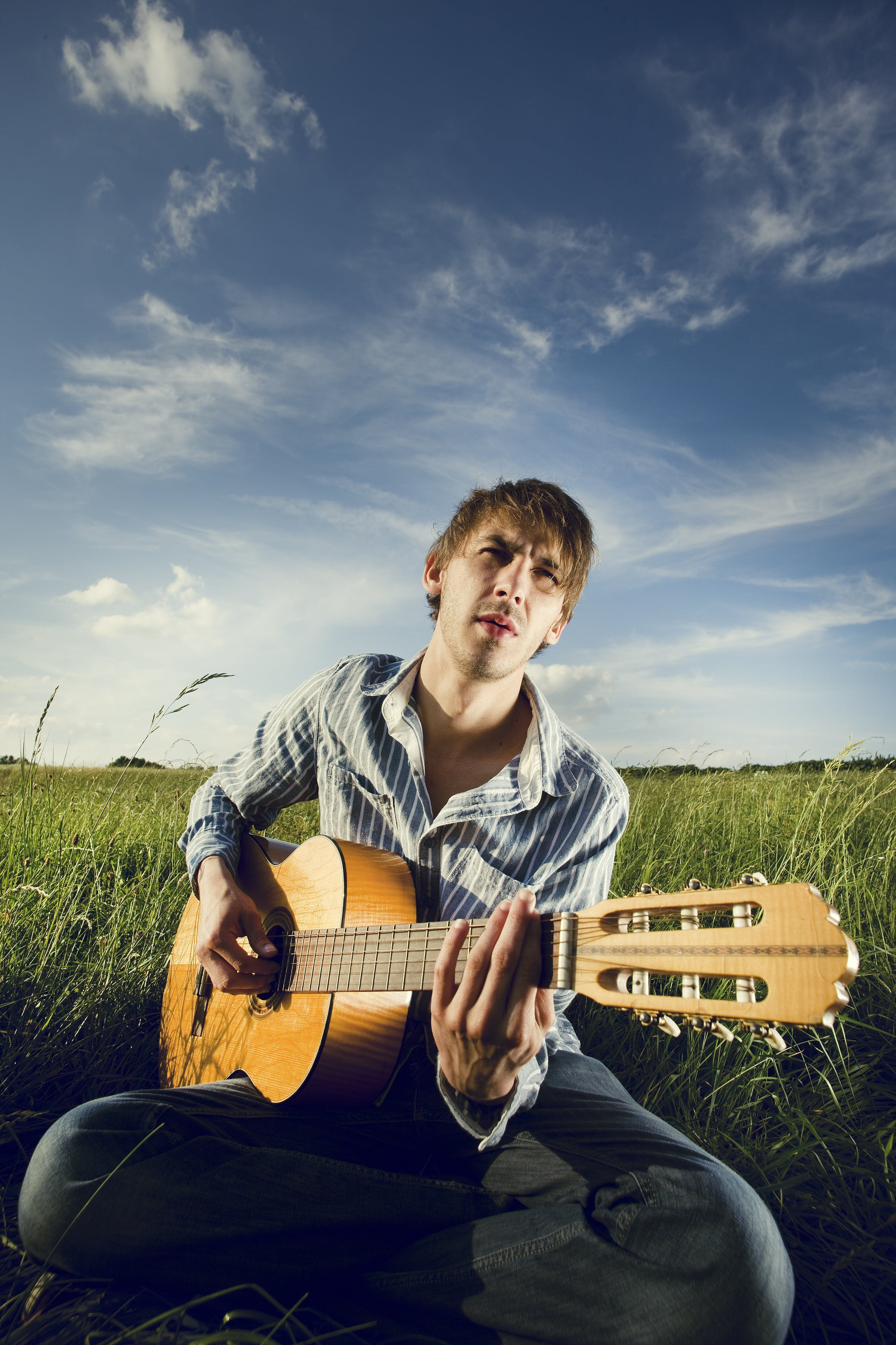 Man Playing Classical Guitar Outdoors