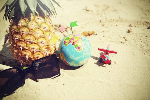 Free stock photo of food, sunglasses, sand, pineapple