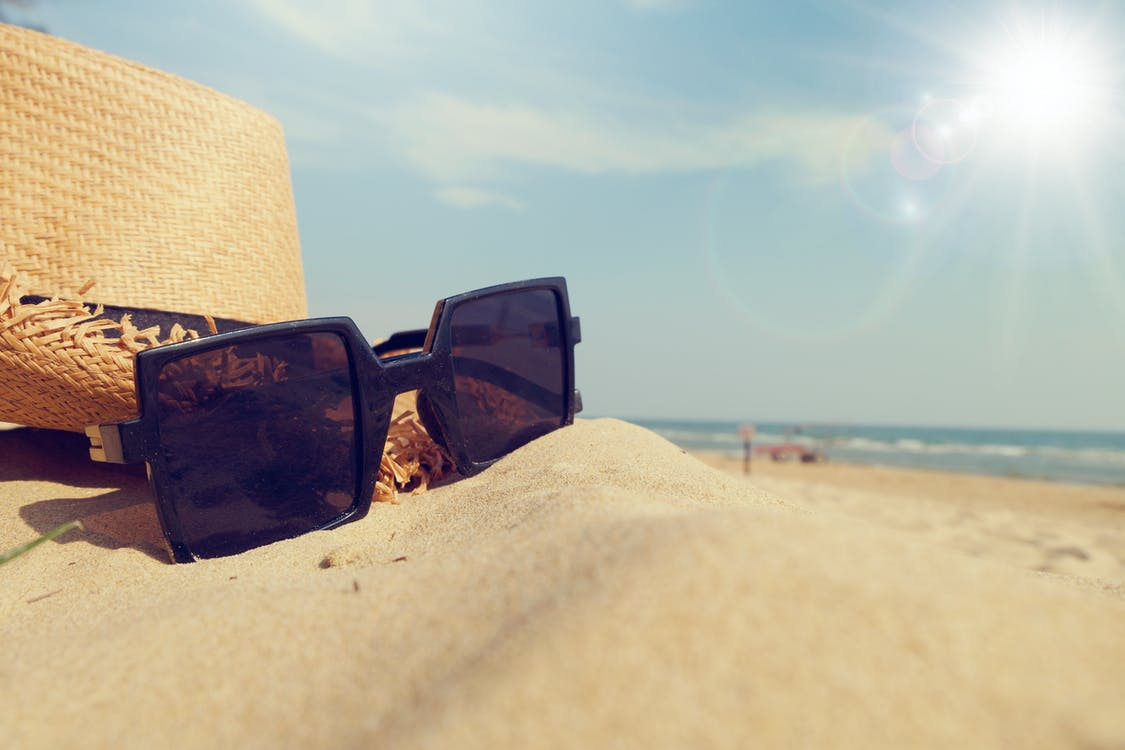 Black Framed Sunglasses on Sand
