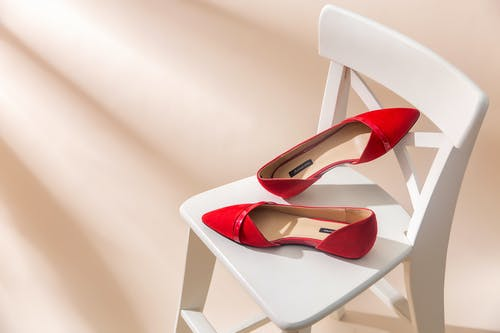 Red Shoes on White Chair