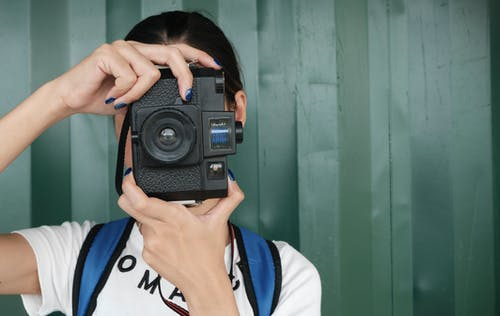 Person Holding Dslr Camera