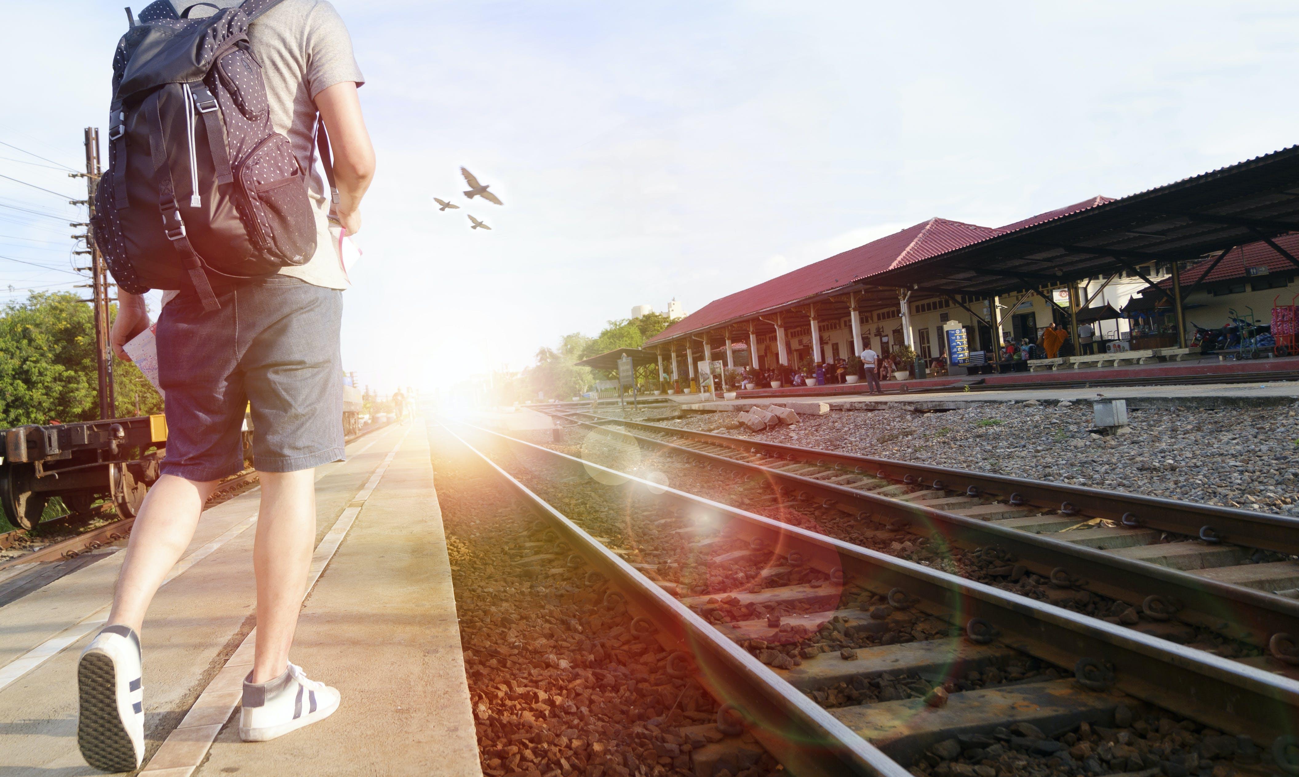 Man Walking Beside the Railway