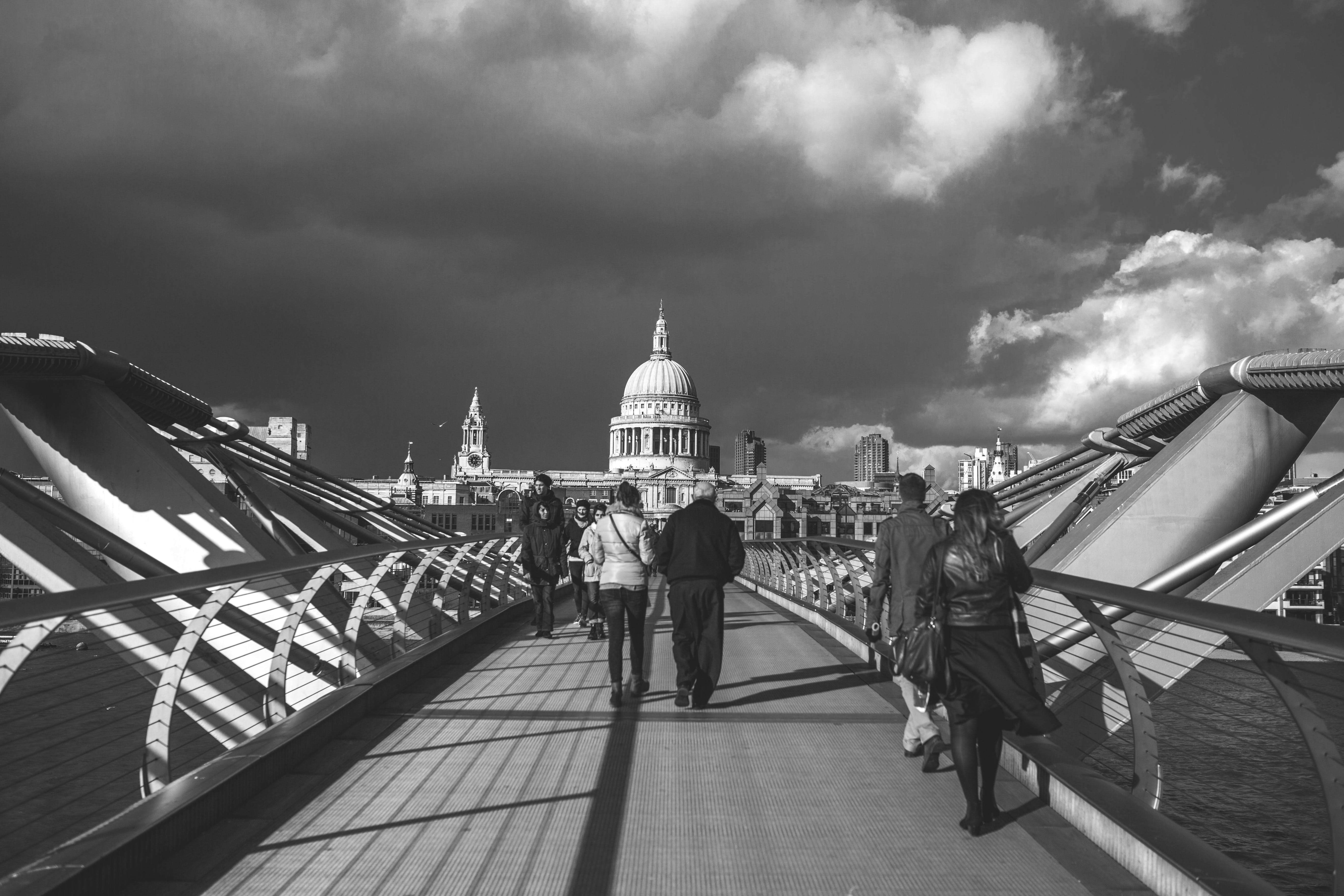 Grayscale Photo of People Walking in Pathway