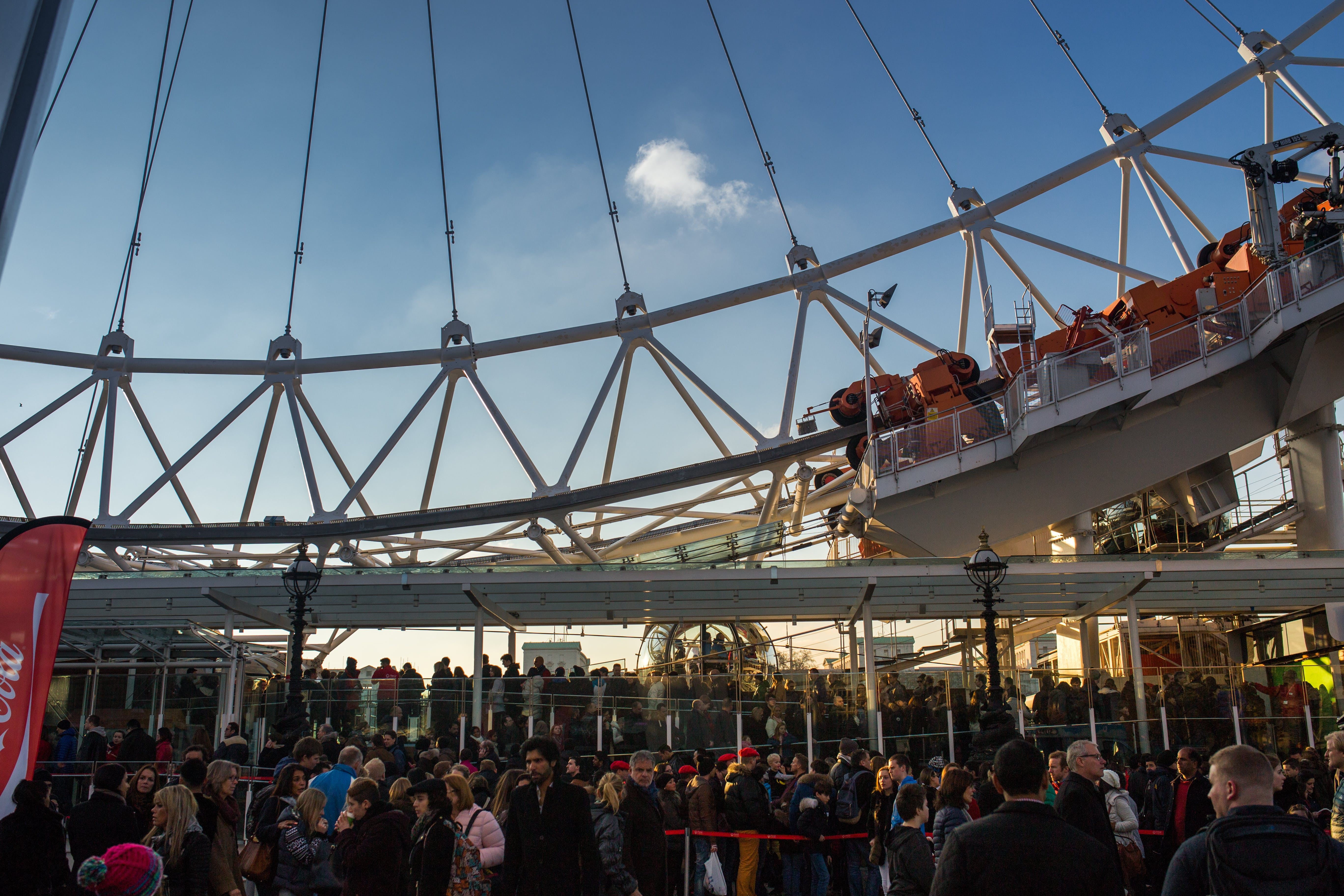 Red White Roller Coaster Under White Cloud and Blue Sky during Daytime