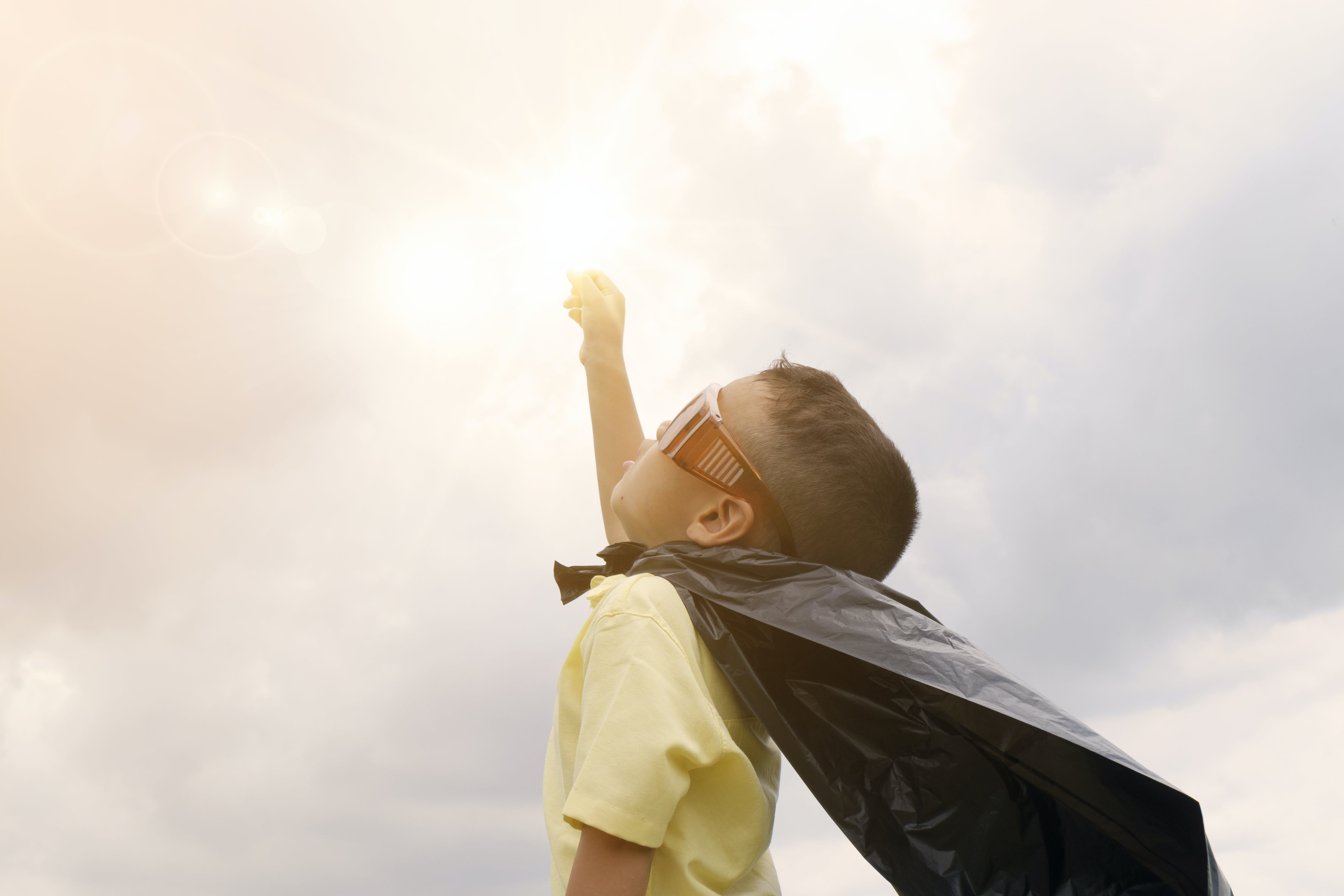 A child with a cape - kids are priority when moving with family